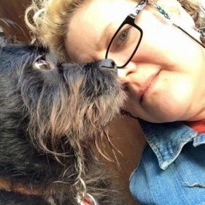Photo of artist Ruth McCabe and her dog Jasper.